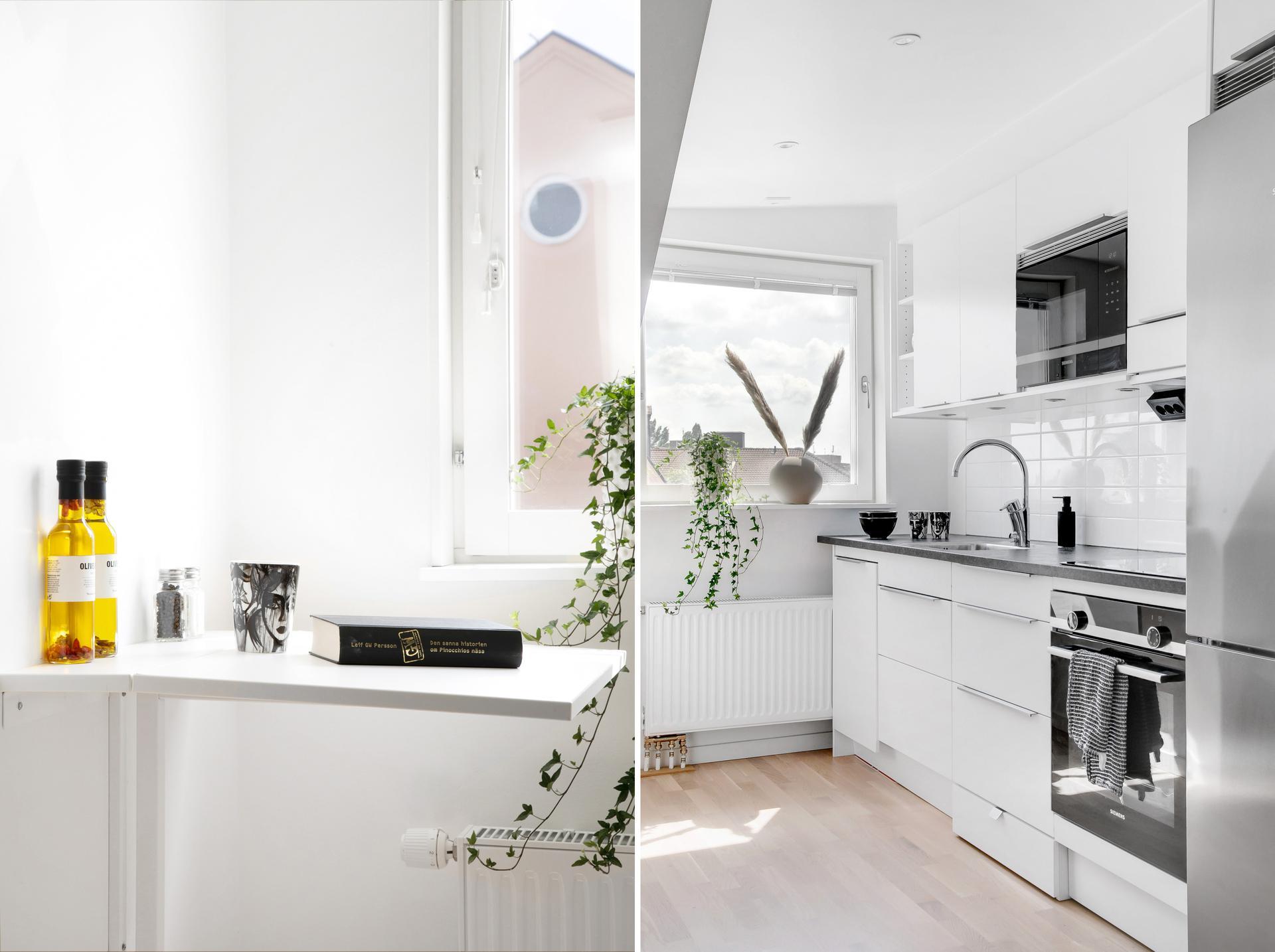 Fullutrustat kök med vitvaror i rostfritt stål